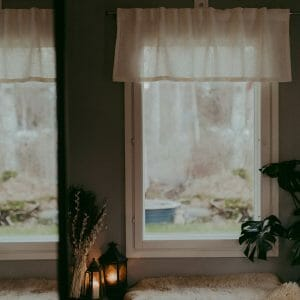 White linen valance hanging in window.